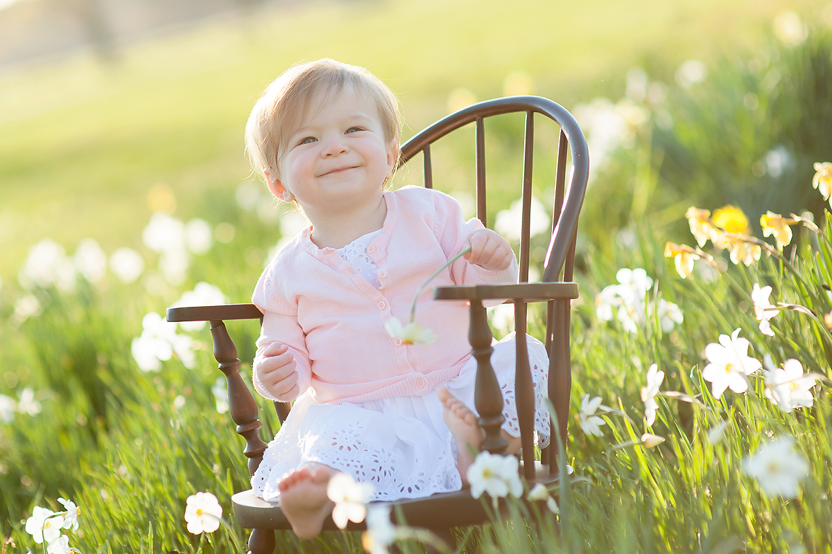baby in a field of daffodils