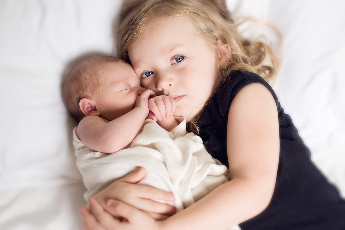 newborn and sibling professional portrait