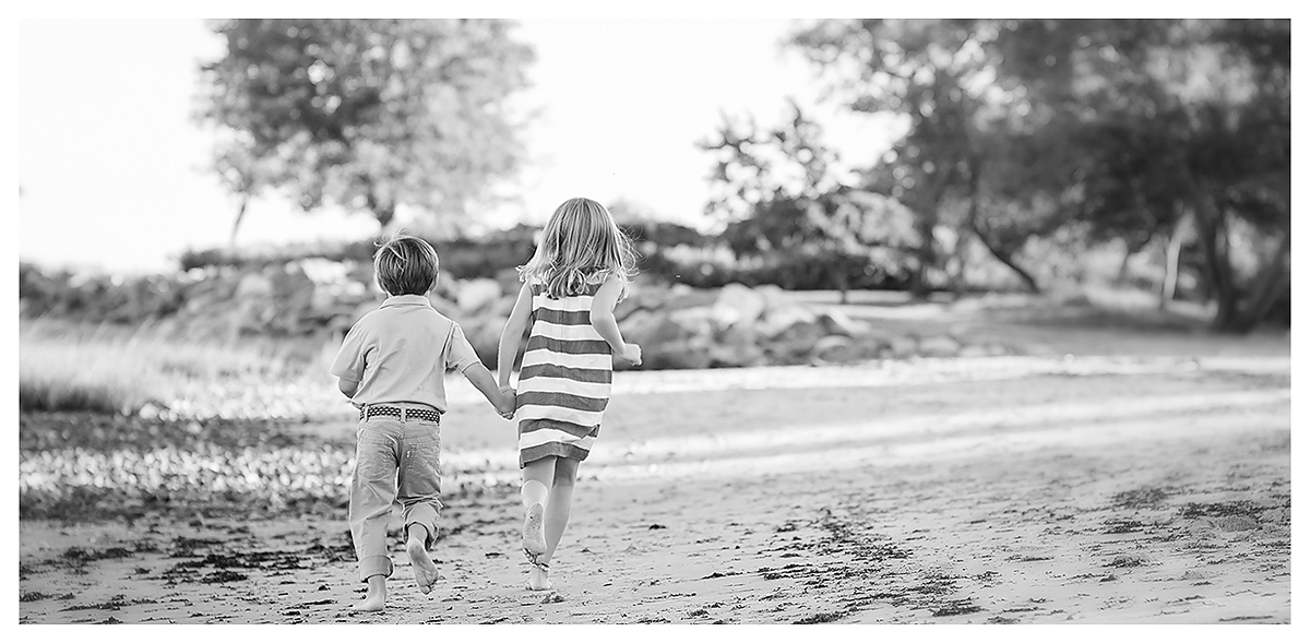 Kids running on the beach at Tod's Point in Greenwich, by top CT Family Photographer Kelli Dease