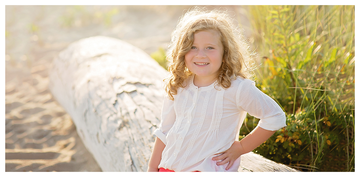 Little girl photographed at Hammanoassett beach in Madison CT by to children's photographer Kelli Dease.