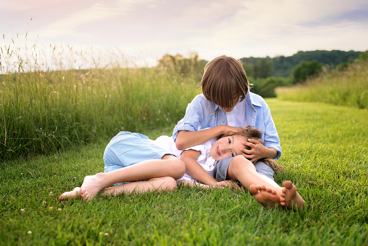 brothers at sunset in field by top ct child photographer kelli dease