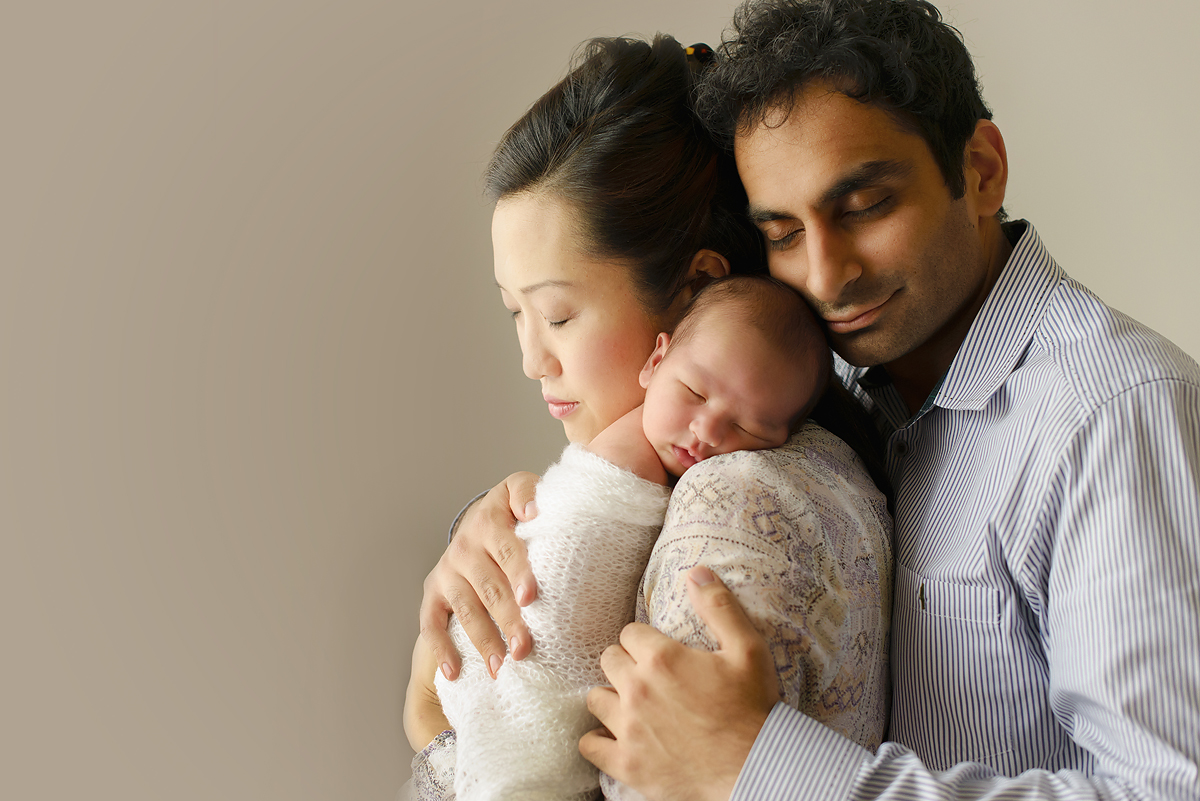 Greenwich CT top newborn photographer. Mother, father and newborn baby.